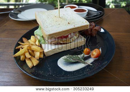 Club Sandwich Look So Delicious Ready To Eat On Wooden Deak.