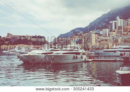 La Condamine, Monaco - June 04, 2019: Yachts Docked At Port Hercules In La Condamine Harbour. Citysc