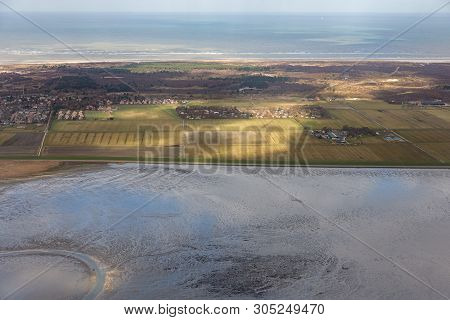 Aerial View Dutch Island Schiermonnikoog While The Sunlight Is Shining At The Fields