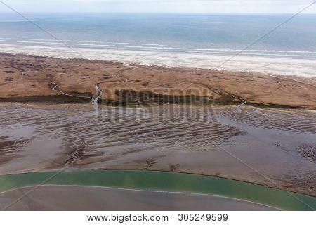 Aerial View Dutch Island Schiermoniikoog, Coastline With Wetlands, Mudflats And Natural Channels