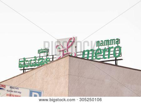 Bangalore, Karnataka, India June 02, 2019: Namma Metro Board On Top Of The Building Near Kempegowda
