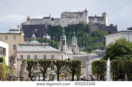 Salzburg Old Town And Hohensalzburg Fortress On Festung Mountain View From Mirabel Park On Sunny Day