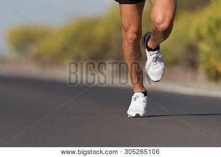 Sport And Fitness Runner Man Running On Road Training For Marathon Run Doing High Intensity Interval
