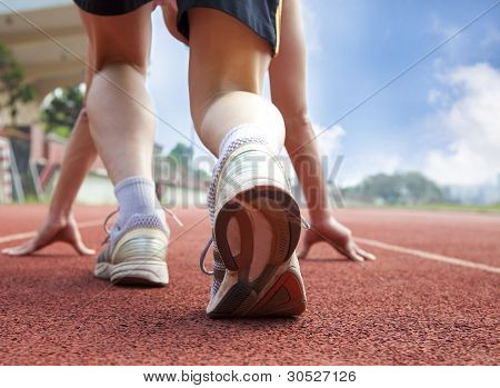 athlete ready for race  in a playground; poster
