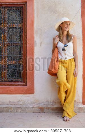 Elegant stylish woman smiling in Moroccan riad poster