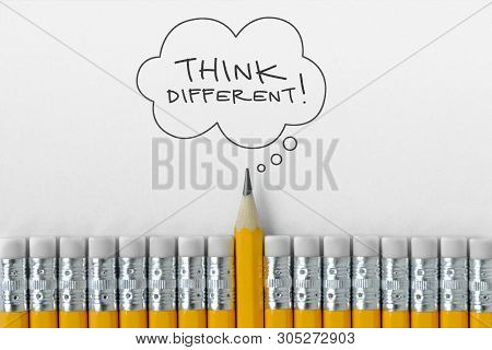 Pencil tip standing out from croud of pencil rubber erasers with Think different word on thought bubble poster