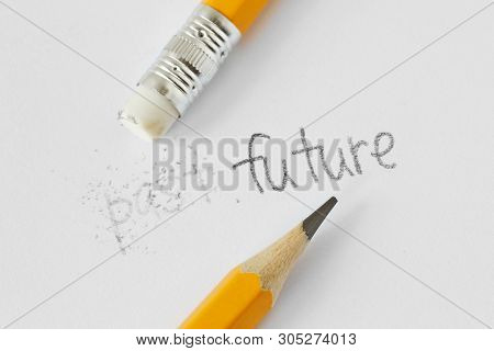 The Word Past Erased With A Rubber And The Word Future Written With A Pencil On White Paper - Concep