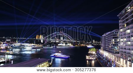 Sydney, Australia - May 27, 2019. Sydney Harbour Bridge At Circular Quay Illuminated With Colourful