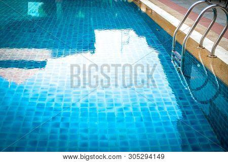 Metal Steel Handle At Edge Poolside Of Swimming Pool In Hotel