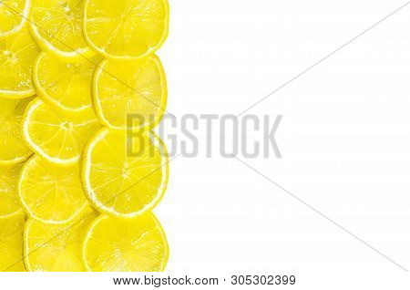Thinly Sliced Lemon Wedges Lie On A White Background