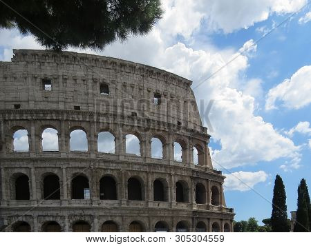 Detailed View Of The Exterior Wall Of The Colosseum Or Flavian Amphitheatre In Rome Against A Blue C
