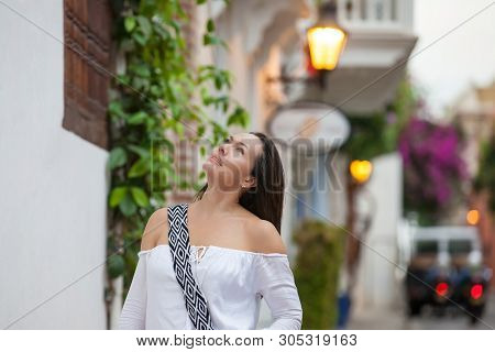 Beautiful Woman At The Streets Of The Walled City In Cartagena De Indias