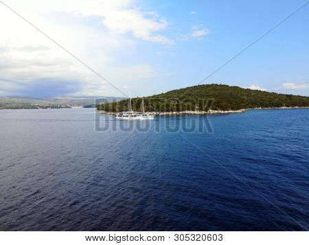 tourist sailing ship and landscape of island Brac near town Milna