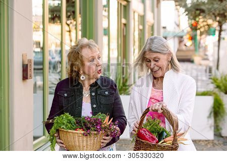 Two Senior Women Returning With Produce From Farmers Market