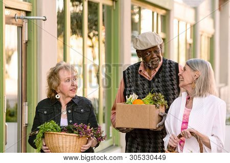 Smiling Seniors Returning With Groceries From Farmers Market