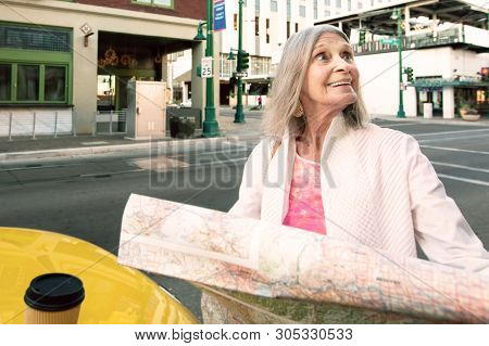 Woman In A City Center With A Holding Road Map