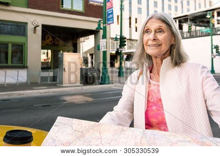 Woman In A City Center With A Road Map