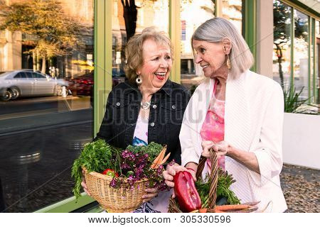 Two Happy Women Returning With Produce From Farmers Market