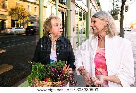 Two Women Returning With Produce From Farmers Market