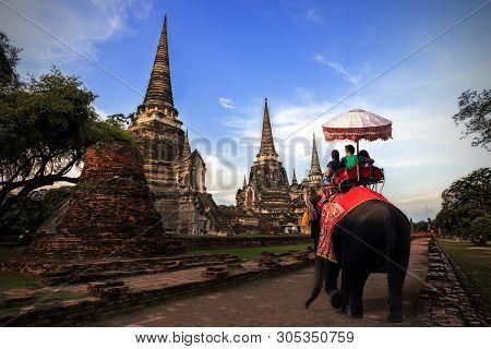 Foreign Tourists Elephant Ride To Visit Ayutthaya, There Are Ruins And Temple In The Ayutthaya Perio