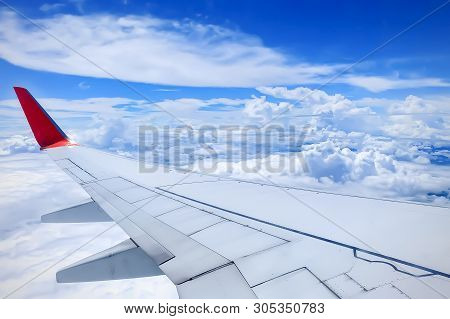 Airplane Wing With Blue Sky From As A Window.