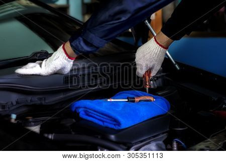 Car Mechanic Is Using A Wrench. Remove The Spare Parts In The Engine In The Garage. Concept Is Servi