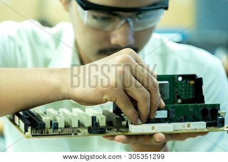 A Technician Is Putting The Ram On The Motherboard In The Socket Computer. Concept Repair Hardware C