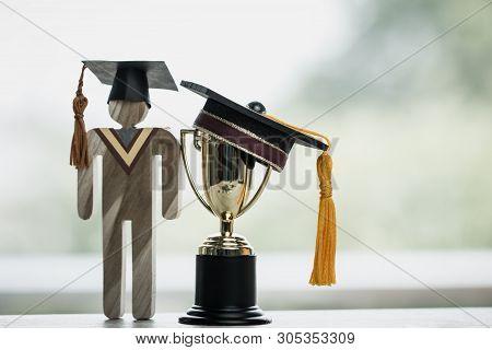 Education Graduation In Achievement Success Concept: Golden Trophy Cup Winner With Students Universi