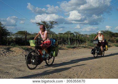 Kenya, Samburu- 01 January 2019:girls Cycling Across Kenya On The Trail