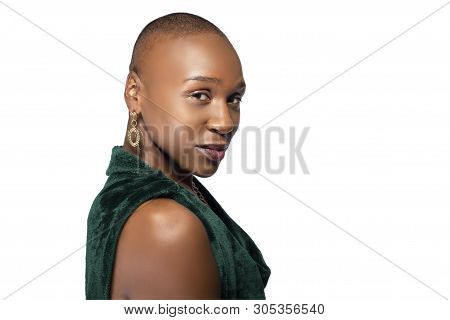 Beautiful Black African American Female Model Posing Confidently With Bald Hairstyle On A White Back