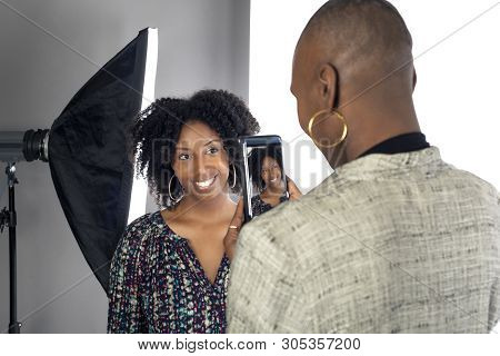 Black Female Actress Doing A Self Tape Audition Via Cell Phone Camera In A Studio While Reading To A