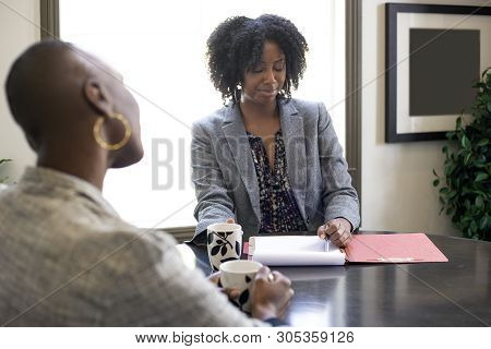 Black African American Female Client Looking Worried While Applying For A Loan Or Employment.  Also