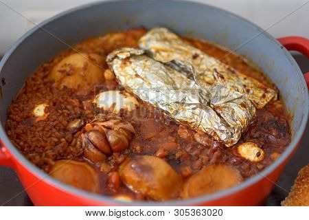 Hot Plate For The Sabbath, A Pot Of Spicy Meat Cooked With Potatoes, Barleys, Jachnun, Garlic, Wheat