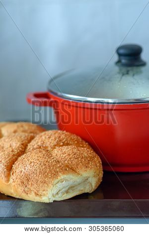 Hot Plate For The Sabbath. Pot With Traditional Food And Challah-special Bread In Jewish Cuisine. Tr