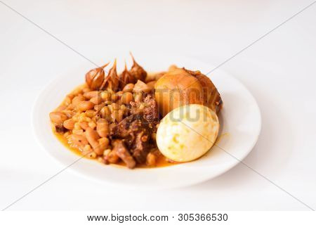Hamin Or Cholent In Hebrew - Sabbath Traditional Food On White Table In The Kitchen.