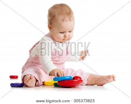 Infant Baby Plays With Educational Toy. Isolated On White Background