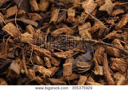 Coconut Husk Chips or coconut shell chips.  Commonly used as soil improvement or conditioner material.