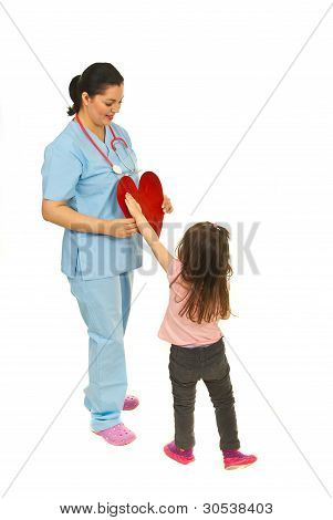 Little Girl Offering Heart To Doctor