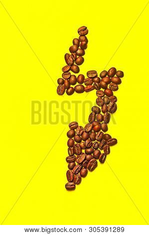 Isolated Lightning Shape Made With Coffee Beans. Symbol Of Superpower With Yellow Background And Cop