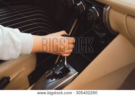 Woman Switches The Automatic Transmission's Close-up. Close-up Of The Driver's Adm Includes Mode Dri