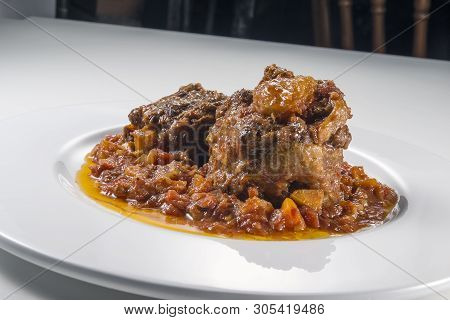 Isolated Dish With A Portion Of Oxtail Stewed Vaccinara