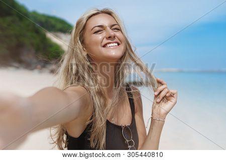 Dreams Do Come True. Joyful Happy Carefree Blond Tanned Woman Enjoy Sun Close Eyes Raise Head Up Che
