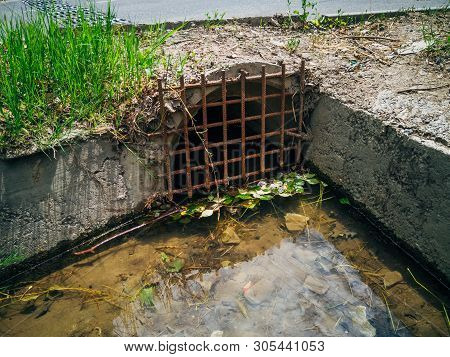 Drainage sewer pipe under road for draining sewage or rainwater poster