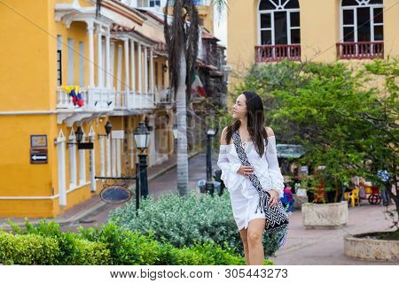 Beautiful Woman On White Dress Walking Alone At The Walls Surrounding Of The Colonial City Of Cartag