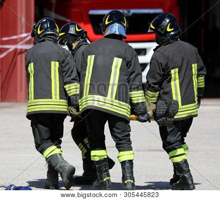 Firemen Rescuers Stretcher Bearer After The Accident