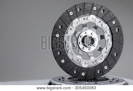 Car Clutch Plate On A Gray Background, New Part, Car Warranty Service