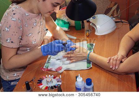 April 28, 2019 Minsk Belarus Manicurist Processes Nails With A Scraper For Manicure At Home