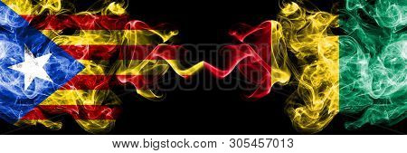 Catalonia Vs Guinea, Guinean Smoke Flags Placed Side By Side. Thick Colored Silky Smoke Flags Of Cat