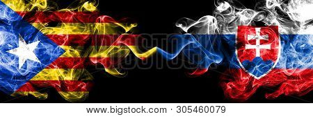 Catalonia Vs Slovakia, Slovakian Smoke Flags Placed Side By Side. Thick Colored Silky Smoke Flags Of