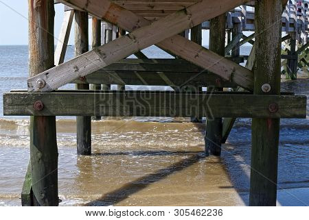 View Of Under The Wood Bridge At Sankt Peter-ording Beach, Northern Germany